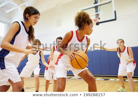Female School Sports Team In Gym With Basketball Stock photo © HighwayStarz