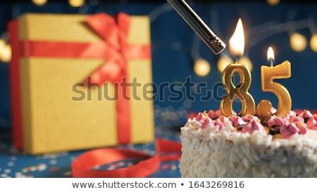 Birthday cake with burning candle number 85 Stock photo © Zerbor