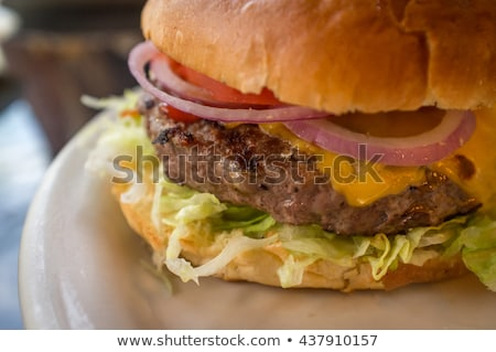 Cheeseburger lecker traditionellen Boden Rindfleisch geschmolzen Stock foto © juniart