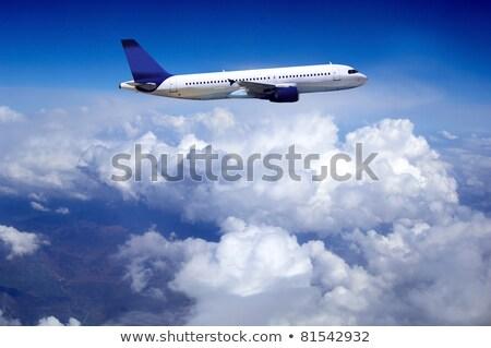 Military transport plane, blue sky background Stock photo © Zhukow