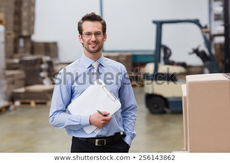 warehouse manager standing hands on hips stock photo © wavebreak_media