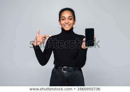 woman showing blank smartphone display stock photo © deandrobot
