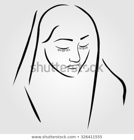 Stock photo: A nun wearing a veil with eyes closed in silent prayer