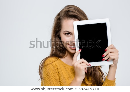 Woman covering half face with tablet computer  Stock photo © deandrobot