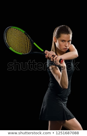 Muscular young woman athlete looking in camera on black  Stock photo © master1305