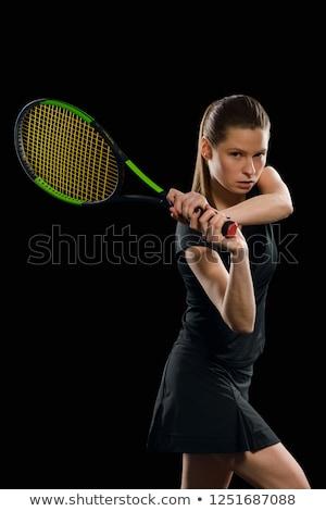 Izmos fiatal nő atléta néz kamera fekete Stock fotó © master1305