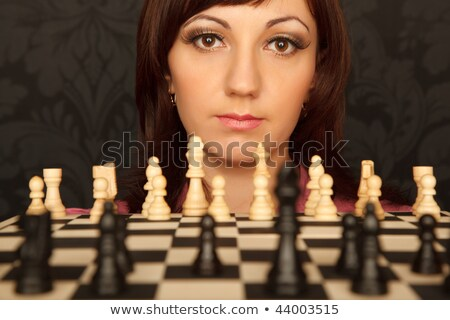 Portrait of girl in red shirt with chessboard.  Horizontal format. Close-up. Stock photo © Paha_L