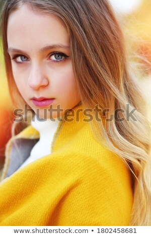 blue-eyed blond with the yellow leaf on the grass Stock photo © Paha_L