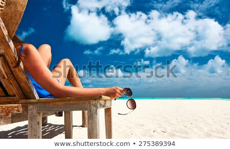 Woman on a lounger in the hat Stock photo © alekleks