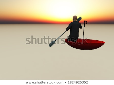 Stock photo: Composite image of businessman in boat with umbrella