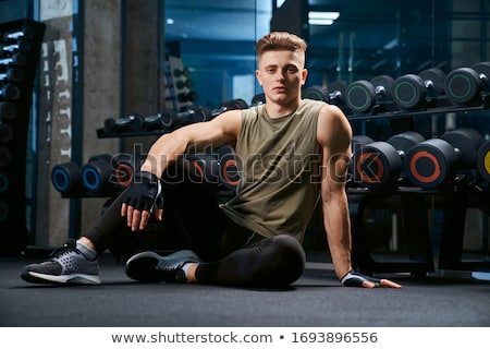 Young Bodybuilder posing in front of the camera Stock photo © wavebreak_media