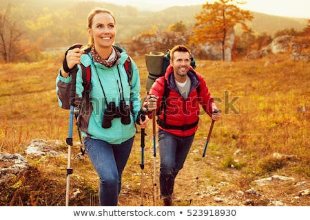 Nordic Walking in Autumn mountains, hiking woman Stock photo © zurijeta