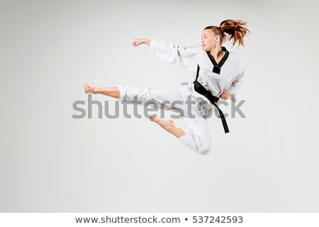 Karatê menina preto cinto pé branco Foto stock © master1305