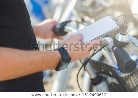 Typing text message during bicycle ride Stock photo © stevanovicigor