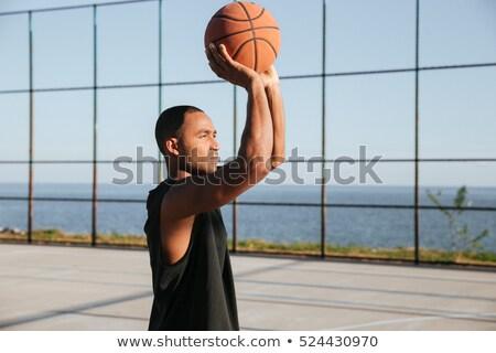 концентрированный афро американский спортивных человека играет Сток-фото © deandrobot