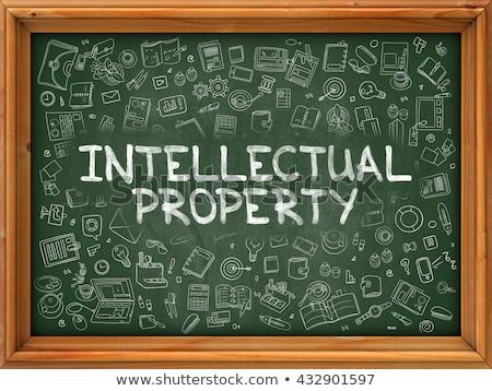 Intellectual Property - Hand Drawn on Green Chalkboard. Stock photo © tashatuvango