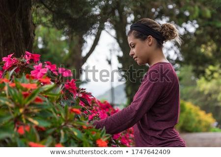 woman with natural makeup posing with lilies Stock photo © LightFieldStudios