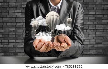 cloud solution on dark brick wall stock photo © tashatuvango