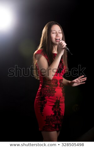 Portrait of a young teen girl in a red dress in the studio Stock photo © RuslanOmega