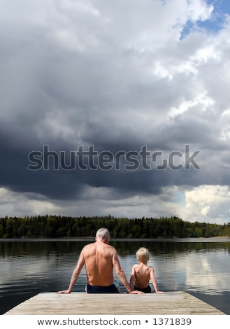 grandfather and children on footbridge Stock photo © IS2
