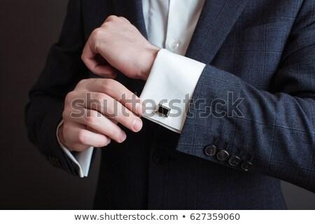 elegnat man in tuxedo is fixing his bowtie  Stock photo © feedough