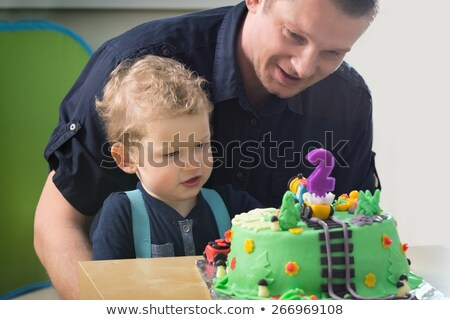 Caucasian boy celebrating second birthday. Stock photo © RAStudio