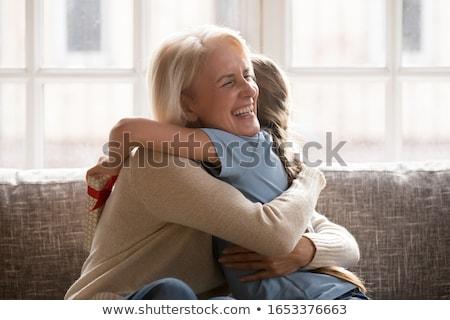 älter Frau halten Enkelkind Glück Sitzung Stock foto © IS2