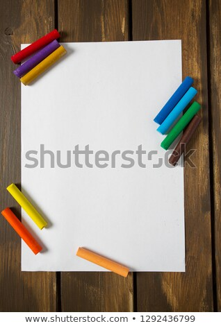 Paper and crayons on a table Stock photo © IS2