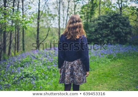 Young woman with bluebell flower Stock photo © IS2