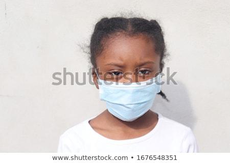 A Sick Boy on Black Background Stock photo © bluering