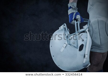 Black and white football against digitally generated grey background Stock photo © wavebreak_media