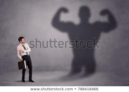 Uomo d'affari guardando proprio forte montare ombra Foto d'archivio © ra2studio