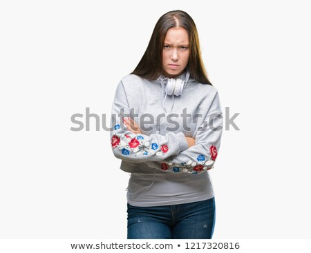Teenage girl with arms crossed frowning Stock photo © monkey_business