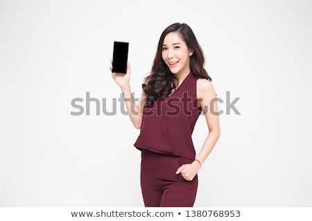 Young woman presenting telephone Stock photo © Traimak