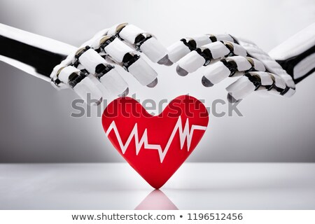 robot protecting heart with pulse rate stock photo © andreypopov