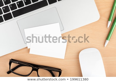 Stock photo: Blank business cards over laptop keyboard