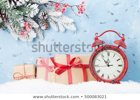 Christmas gift boxes, alarm clock and fir tree stock photo © karandaev