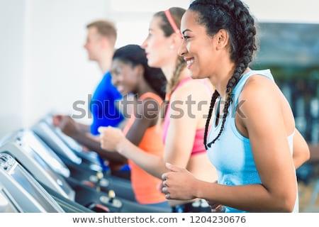 Zijaanzicht geschikt gelukkig vrouw opleiding groep Stockfoto © Kzenon