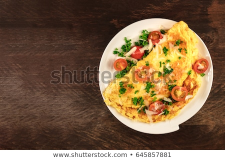 Delicious homemade egg omelette with tomatoes and parsley Stock photo © dash