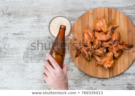 male hand with glass of alcohol on table Stock photo © dolgachov