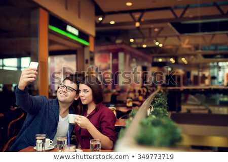Young couple taking a selfie in a mall Stock photo © Minervastock