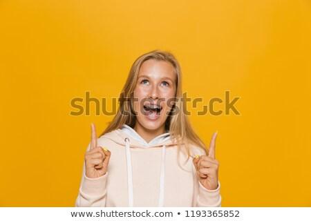 Fotó izgatott iskolás lány fogászati fogszabályozó mutat Stock fotó © deandrobot