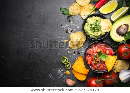 Foto stock: Guacamole Salsa Chips Nachos And Tequila