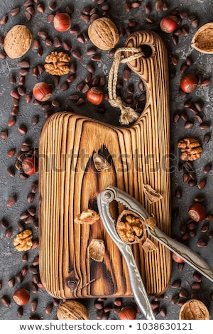 old cutting board and different nuts on stone table stock photo © valeriy