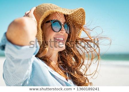 вид сбоку счастливым женщину соломенной шляпе Солнцезащитные очки брюнетка Сток-фото © deandrobot