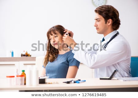 Patient with hearing problem visiting doctor otorhinolaryngologi Stock fotó © Elnur