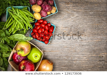 Variety of green organic vegetables on rustic wooden background. Stock photo © marylooo