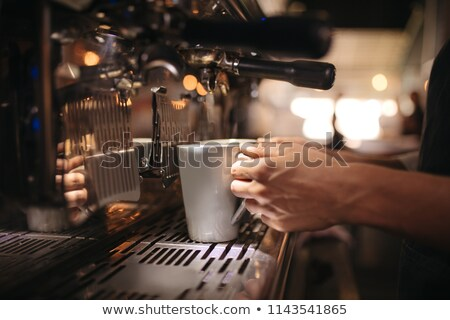 Person Holding Coffee Cup Under Coffee Maker Stock photo © AndreyPopov