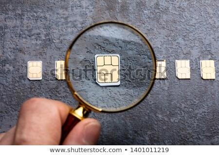 Lupa nano cartão pessoas mão Foto stock © AndreyPopov
