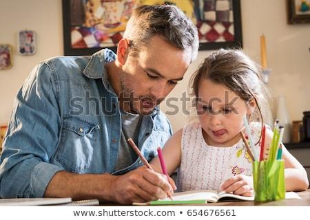 Ojciec córka praca domowa domu szczęśliwą rodzinę dziecko Zdjęcia stock © boggy